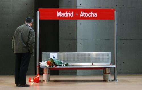 A man pays his respects at memorial site at Madrid's Atocha station.